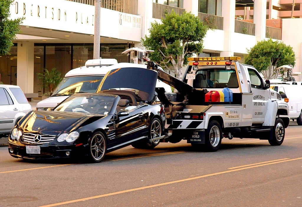 A black Mercedes-Benz driven by actress Lindsay Lohan is taken away by a tow truck after the actress collided with a van on Robertson Boulevard in West Hollywood, California on Tuesday, October 4, 2005. Lohan and a female passenger in her car suffered min